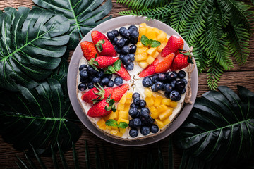 delicious mix fruit cake on wooden table