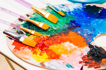 Set for drawing and art painting with color palette and watercolor paints on table