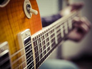 Closeup of guitarist playing electric guitar