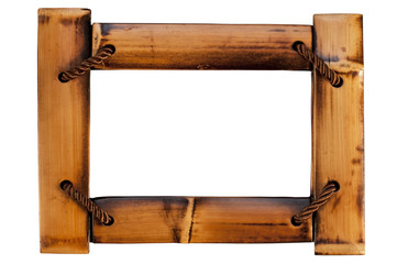 Beautiful wooden frame made of bamboo and threads on a white background for photographs
