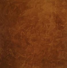 Коричневый фон с мазками в вечернем свете. Венецианская штукатурка - декоративное покрытие для стен