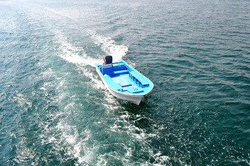 motor boat sails on the waves of the Gulf of Oman