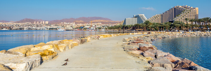 Morning view on Eilat - a famous Israeli city with beautiful sandy beaches, hot sun and clear blue skies, surrounded by stunning mountains and desert scenery