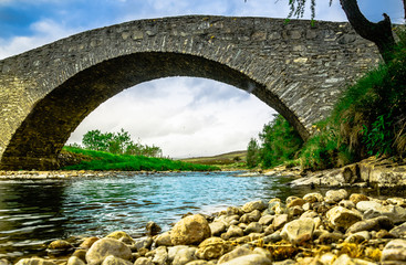 View on old stone bridge in the Highlnads of Scotland
