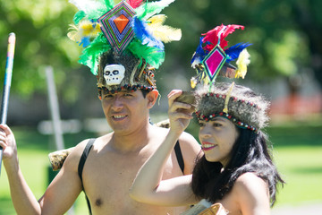 Tribal couple wearing traditional Peruvian clothing and dancing Anaconda dance, a musical genre typical of Amazon region of Peru