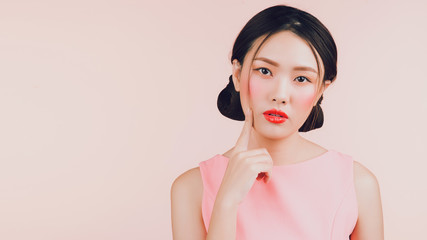Beautiful asian young woman with fashion makeup isolated on pink. Cosmetics and make-up
