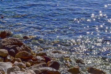 The sea view. Calm sea and large stones. Transparent water of the Adriatic Sea. Montenegro