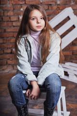 Portrait stylish model child. child fashion concept. girl jeans clothes.