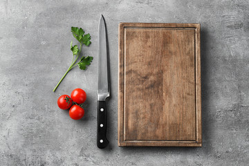 Kitchen utensils and vegetables on grey background. Cooking master classes