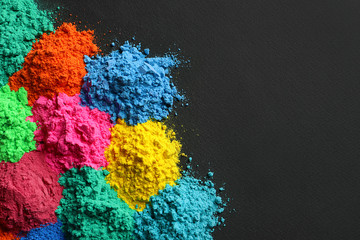 Colorful powders for Holi festival on dark background