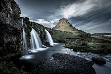 Kirkjufell and waterfall, green landscape. Snaefellsnes peninsula, Iceland