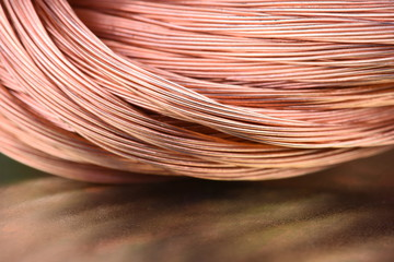 Copper wire raw materials and metals industry closeup on metal background