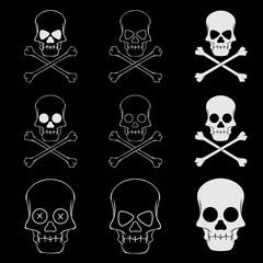 Cross bones skulls set on black background. Symbol of danger and death.