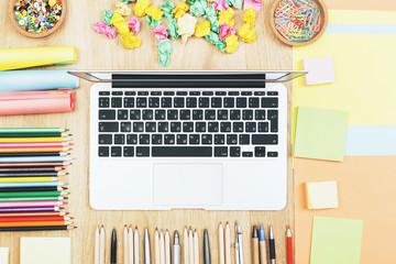 Modern office desktop with laptop