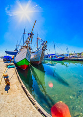 Traditional boats in Paotere harbor, Makassar, Indonesia. Indonesian sailor have been using this kind of boat called Pinisi to sail as far as Africa since 14 century.