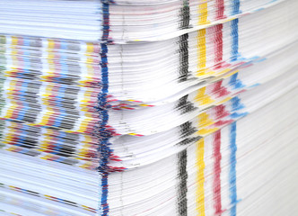 Stack of paper with CMYK