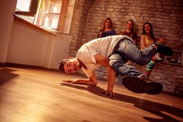 Young hip hop men performs break dancing moves