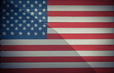 American flag pattern on wooden board texture. Vintage painted USA symbol texture on grunge wall fence. Room for text, copy space