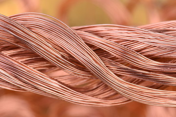 Bundle of copper wire on blurred background