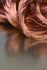Closeup of Copper Wire on Metal Surface with Reflection