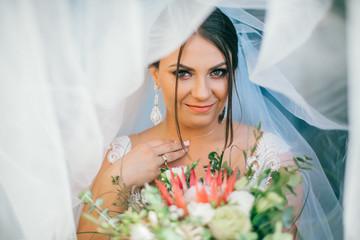 Wedding ceremony. Tender portrait of a beautiful bride under a veil.