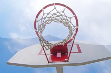 Basketball Hoop against a blue sky. Bottom view