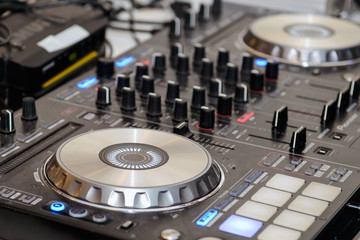 DJ music mixer at the party. Audio equipment for professional DJs.