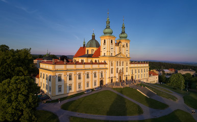 """Aerial view on Pilgrimage Church of the Visitation of the Virgin Mary - pilgrimage site of European significance """"The Holy Hill"""", from-afar visible silhouette of basilica minor against blue sky."""