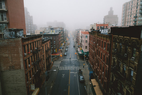 View of cityscape with street during foggy weather