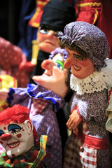 Group of thread marionettes in a theater