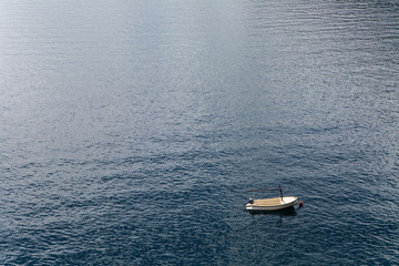 white boat with oars berth at sea