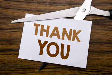 Hand writing text caption inspiration showing Thank You. Business concept for Gratitude Thanks Written on note, wooden back with colourful scissors meaning destroy stop of something.