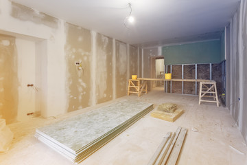 Working process of installing metal frames and plasterboard (drywall) for gypsum walls and materials are in apartment is under construction, remodeling, renovation, extension,