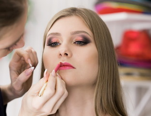 Face, hand working, pink make up