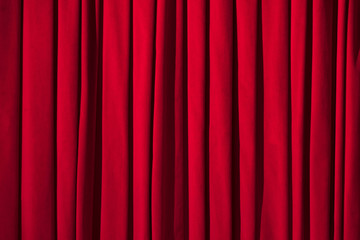 Red curtain theater background with folds, shadows and highlights.