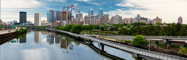 Philadelphia Pennsylvania skyline along the river with walking path