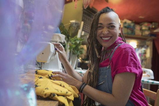 Portrait of smiling young female designer working at studio