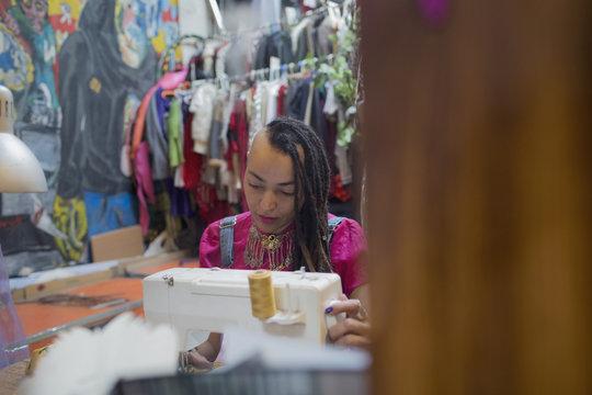 Young female designer working at studio