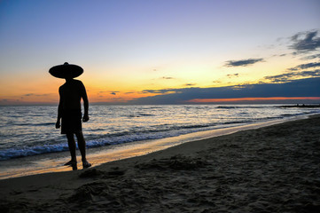 man silhouette at sunset near the sea
