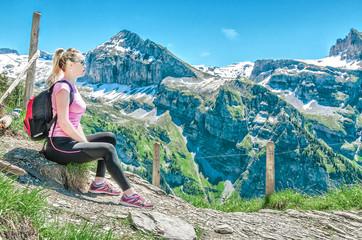 Girl travels to the Swiss mountainous surroundings, Engelberg resort, Switzerland