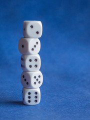 Stack of White Dice on Blue Background