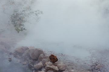 Discovering Northern Thailand. Picturesque scenery in National park, early morning .Hot springs and mist from the steam.