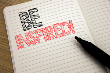Handwriting Announcement text showing Be Inspired. Business concept for Inspiration, Motivation written on notebook with copy space on book background with marker pen