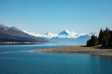 Mount Cook set against the blue waters of Lake Taupo, New Zealand