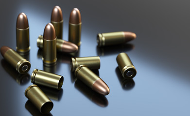 Pistol cartridges of caliber 9 mm on gray background.