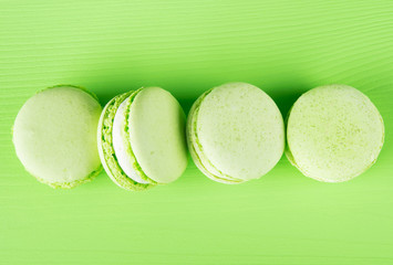 long row of light green  macaron, on a green background