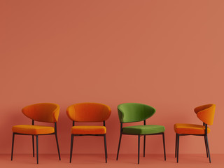 A green chair among orange chairs on orange pastel backgrond. Concept of minimalism. 3d rendering mock up