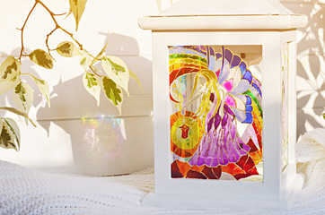 Unique handmade lantern with stained glass painting. Magic candle holder