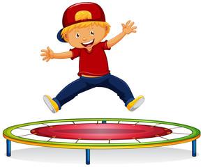 Happy boy jumping on trampoline