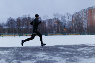 Picture of running athlete at stadium in winter